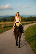 Active young woman ride a horse in nature
