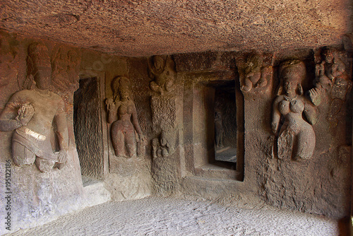 Cave 9, interior carved figures, left wall with door into left vestibule. Aurangabad Caves