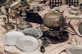Brass containers and plates, candle holders  and other old vintage copper cookware in the flea market. Still life toned image. - 195123340