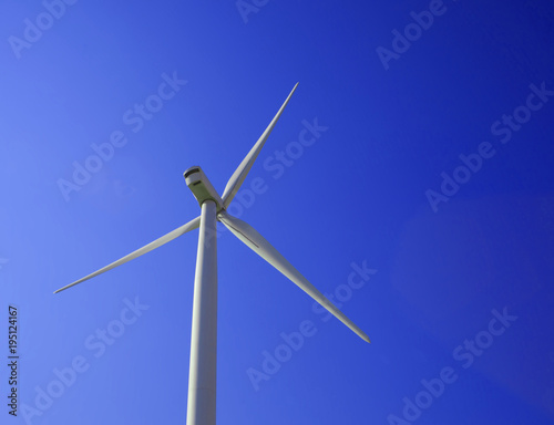 Foto op Plexiglas Donkerblauw wind power plant with blue sky