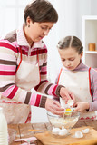 Mother and daughter cook at home. Kitchen interior, healthy food concept - 195125775