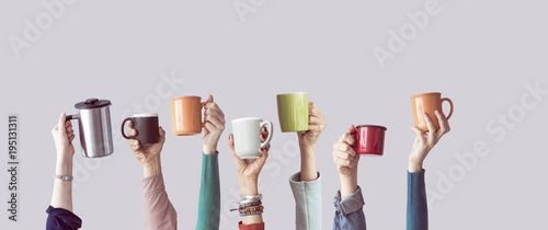 Many different arms raised up holding coffee cup - 195131311