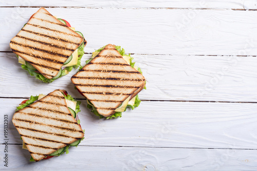 Club sandwich with tomatoes , cucumber , ham and cheese