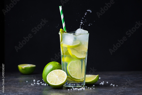 Foto op Canvas Opspattend water fresh summer caipirinha cocktail with splash
