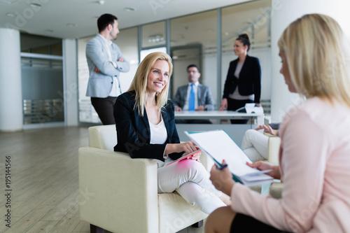 Staande foto Wanddecoratie met eigen foto Picture of attractive saleswoman working in office