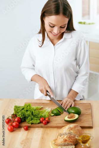 Healthy Diet. Woman Cooking Food, Cutting Vegetables For Salad - 195154385