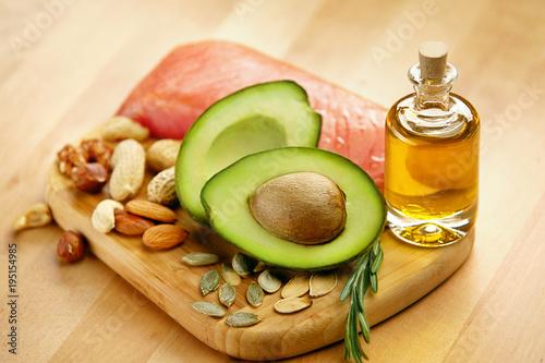 Foto Murales Healthy Food. Ingredients Full of Healthy Fat On Table.