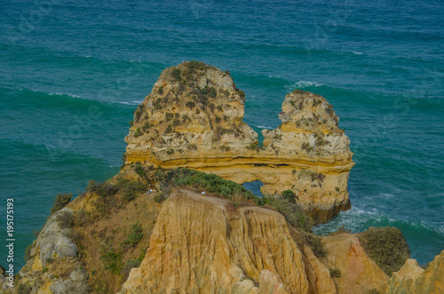 Papiers peints Bleu vert Tiny sandy Praia do Camilo beach near Lagos, Portugal.