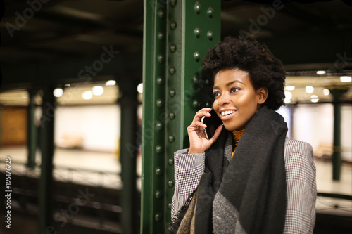Smiling woman doing a phone call