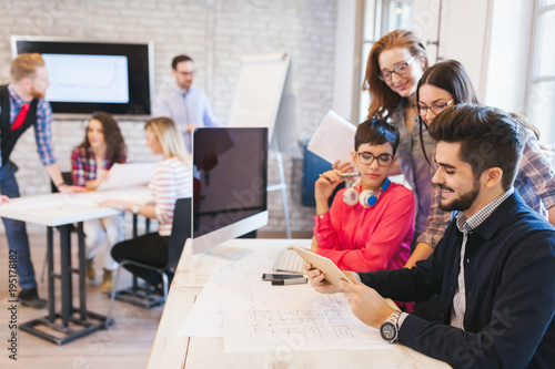 Foto Murales Picture of architects working together in office