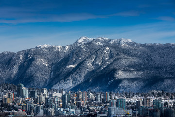 Rocky Mountains and buildings, North Vancouver, British Colombia, Canada.