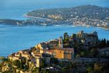 The Village of Eze (Èze), the Mediterranean Sea and Saint-Jean-Cap-Ferrat at sunrise. Alpes-Maritimes, French Riviera, Cote d'Azur, France - 195185355