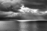 Seascape with Clouds and Beam of Light One Boat Black and White - 195190351