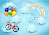 Surreal sky with clouds, rainbow and hanging bike