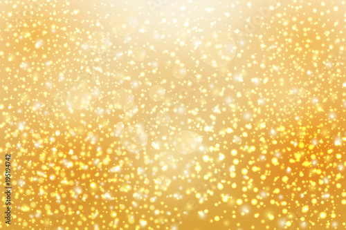 Abstract falling golden lights. Magic gold dust and glare.