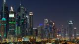 Panoramic view of Dubai skyscrapers at nignt