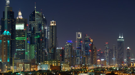 Panoramic view of Dubai skyscrapers at nignt