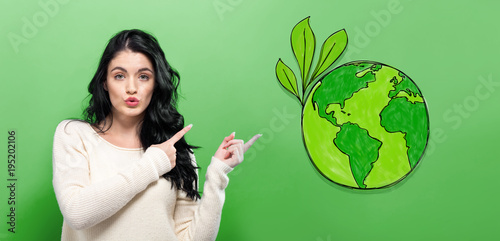 Foto Murales Green Earth with young woman on a green background