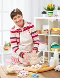 Woman cooking at home kitchen. Healthy food concept - 195216311