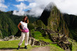 Tourist in the Machu Picchu ruins, remote, spectacular the Inca ruins near Cuzco, Peru, South America