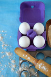 Eggs, flour and kitchen utensils for cooking homemade dumplings on blue background - 195219183