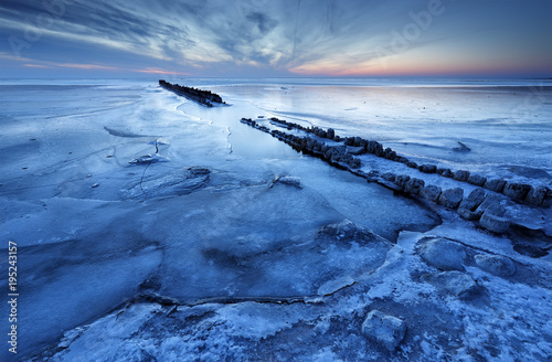 Aluminium Pier old wooden breakwater on frozen coast