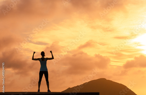 Confident strong woman silhouette.