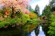Pond with reflections in a beautiful garden with flowering trees during spring. Butchart Gardens, Victoria, Canada.