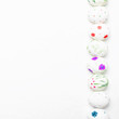 White easter eggs with a hand-drawn pencil pattern, white background, top view