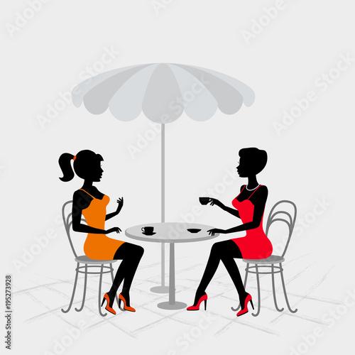 Fototapeta Two women sitting in street cafe