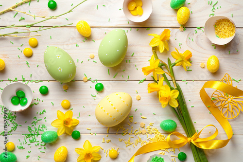 Fototapeta Easter Background with Easter Eggs and Spring Flowers
