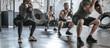 Leinwanddruck Bild - Sportsmen and Sportswomen Lifting Weights at Gym