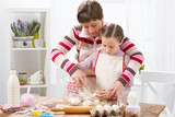 Mother and daughter cook at home. Kitchen interior, healthy food concept - 195301907