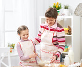 Mother and daughter cook at home. make the dough for buns - 195301947