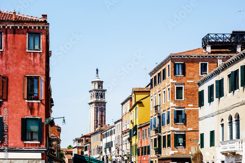 Fototapeta VENICE, ITALY - May 18, 2017 : street view of old buildings in Venice on May 18, 2017. its entirety is listed as a World Heritage Site, along with its lagoon