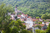 Village houses surround the church in Cabrerets, Lot, France, Europe - 195305712