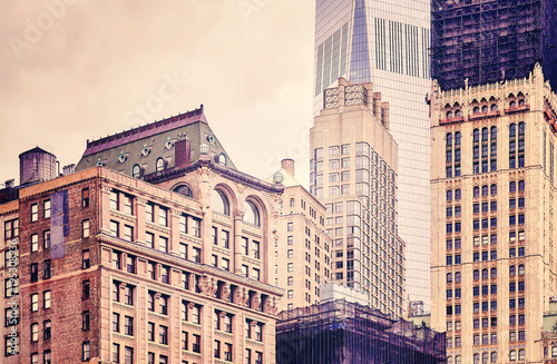 Retro stylized picture of old and modern buildings in New York City, USA. - 195308936
