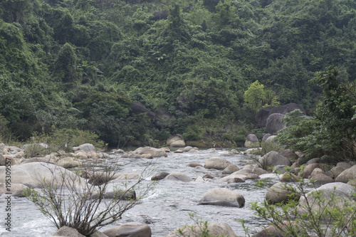 Foto op Canvas Khaki Mountain swamped river in Vietnam