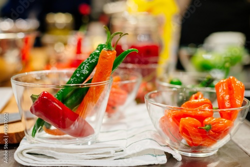 Tuinposter Hot chili peppers Spicy red, orange and green pepper