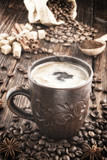 clay cup with coffee on the background of grains