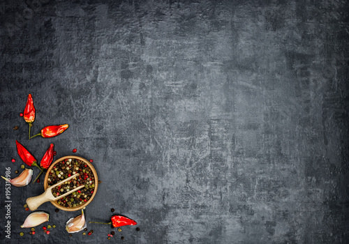 A set of fragrant spices. A mixture of black and red pepper, coriander, paprika. On Wooden background. Top view. Free space.