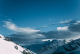 amazing snow-capped mountain peaks and cloudy sky, mayrhofen, austria