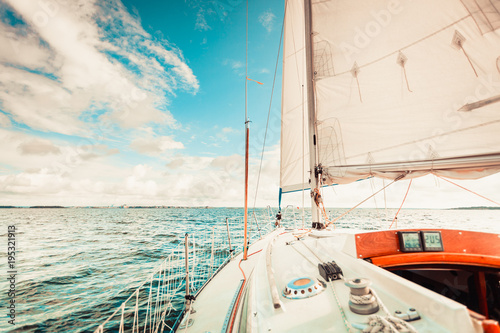 Fotobehang Zeilen Yachting on sail boat during sunny weather