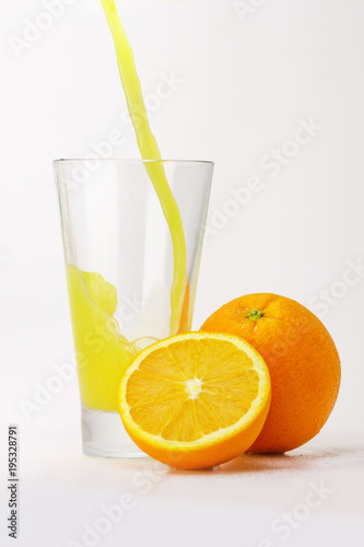Foto op Canvas Sap Orange juice pouring into a glass.