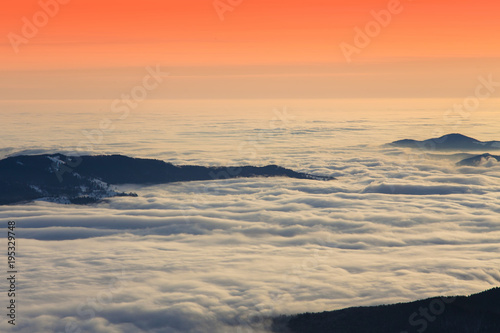 Fotobehang Natuur beautiful sunset or sunrise above the clouds. Romania