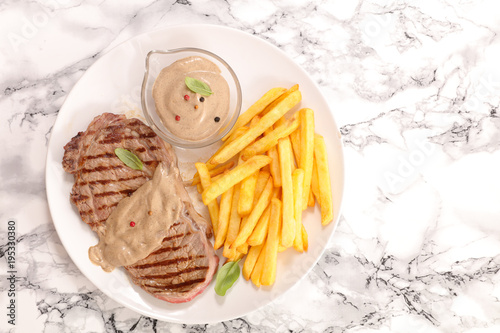 Fotobehang Steakhouse beef steak with pepper sauce and french fries