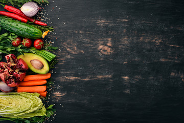Set of fresh vegetables and fruits. On a wooden background. Top view. Copy space.