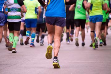 marathon runners through the city streets, motion blur effect