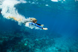 Happy family - active teenage girl jump and dive underwater in tropical coral reef pool. Travel lifestyle, water sport, snorkeling adventure. Swimming lessons on summer sea beach vacation with kids - 195347533
