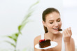Woman Eating Cake. Beautiful Female Eating Dessert